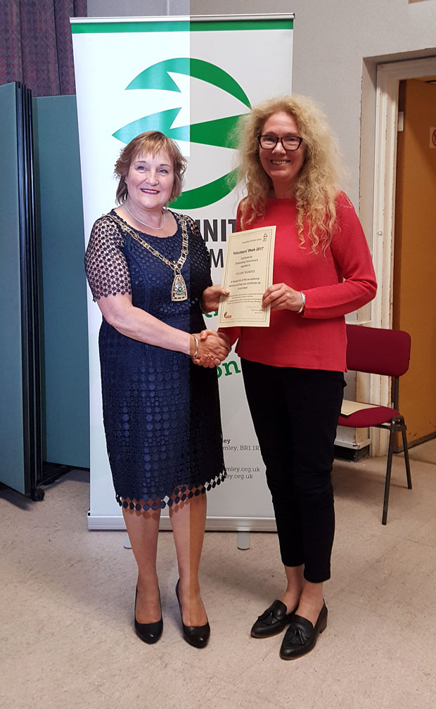Linda Gabriel collects Mike Ricketts' award for Supporting the Work of an Organisation Award