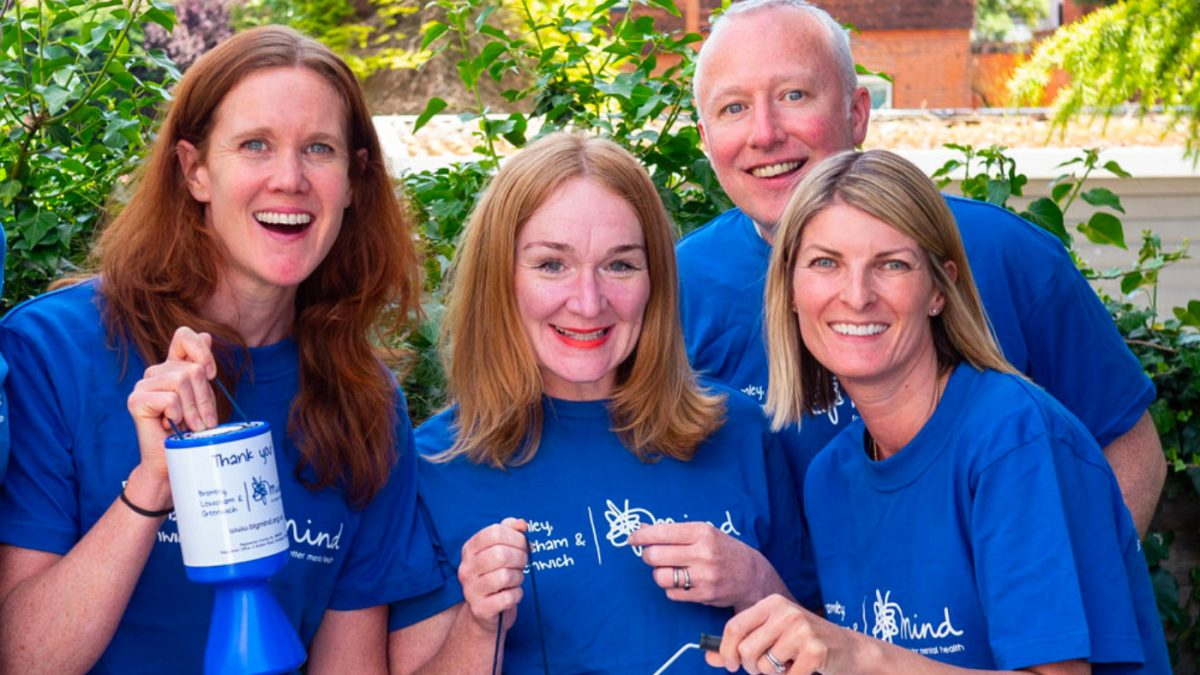 5 fundraising volunteers in BLG Mind t-shirts with fundraising tins and buckets