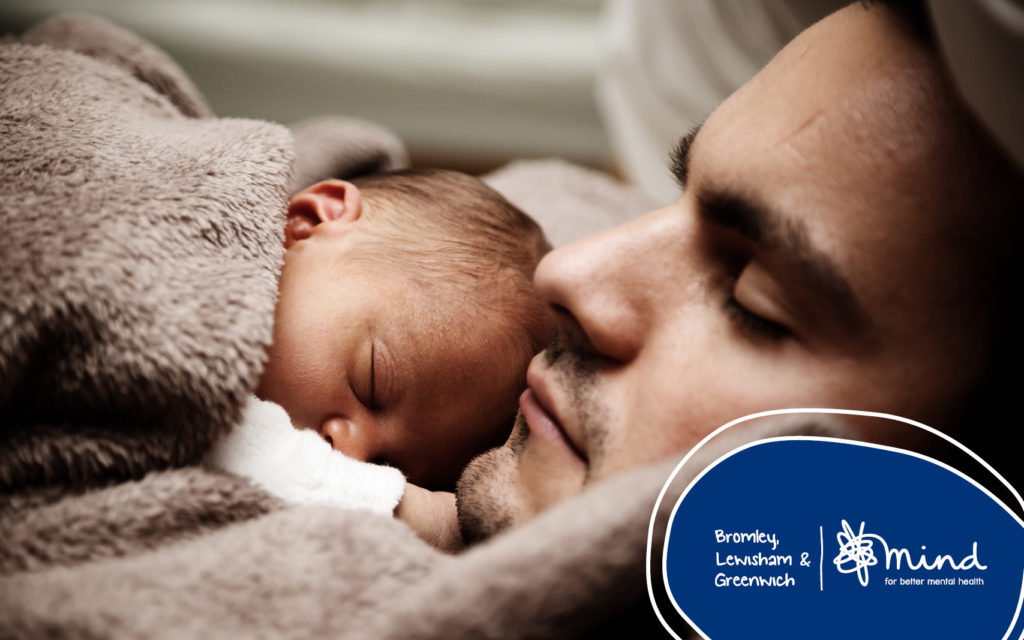 close up of dad sleeping with newborn on chest
