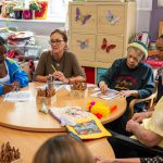 young people, care workers and people with dementia doing some artwork