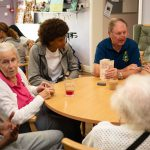 People with dementia, care workers and young volunteers taking part in a quiz