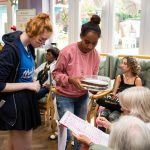 Young volunteers selling raffle tickets to fundraise for Bromley MindCare Dementia Support charity
