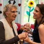 woman with dementia dancing with care worker
