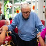 Man with dementia dancing at party