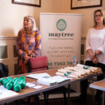 Two volunteers from Maytree at their stall at Bromley World Mental Health Day 2019 event