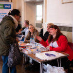Two women speaking at Community Options stand at Bromley World Mental Health Day 2019 event