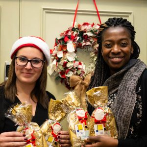 Volunteers from Thackray Williams with Christmas gifts for MindCare dementia clients