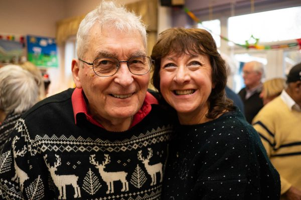 man with dementia and wife smiling happily and dancing at MindCare Christmas Party 2019