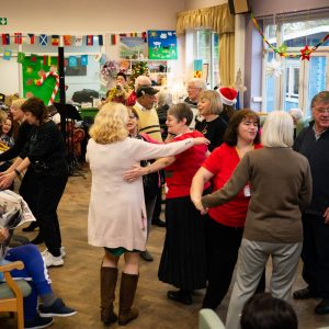 People dancing at MindCare Dementia Christmas Party 2019