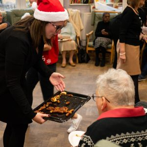 Volunteers from Thackray Williams serving food at MindCare Christmas Party