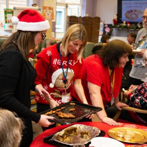 Volunteers and staff serving food at MindCare Christmas Party