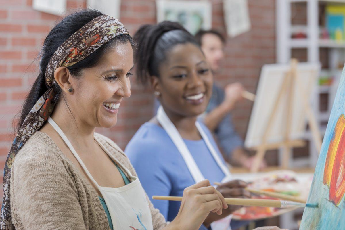 Ethnically diverse women enjoying an art class.