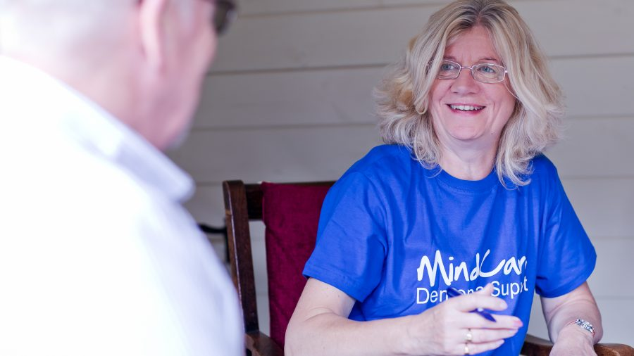 A MindCare dementia staff member speaking with a client