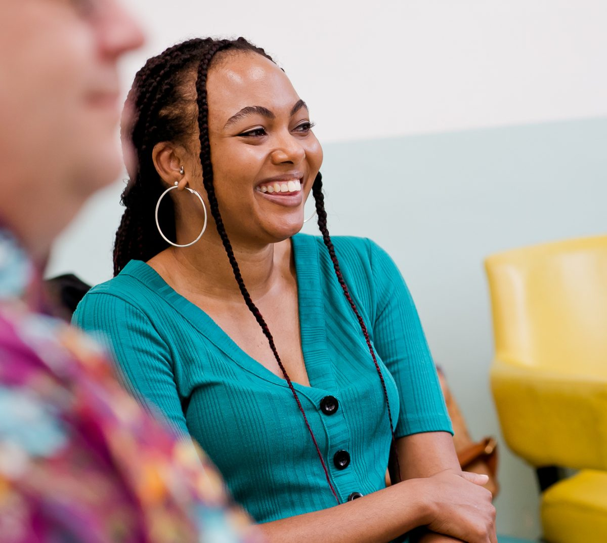 Woman smiling during group therapy