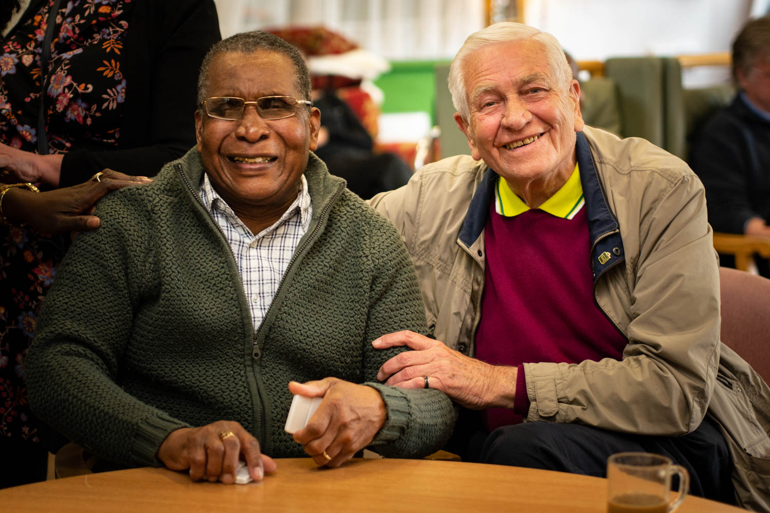 Two elderly men smilimg