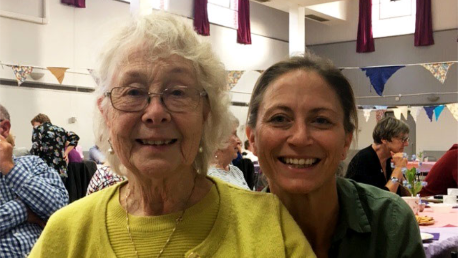 An elderly lady and a volunteer dementia befriender