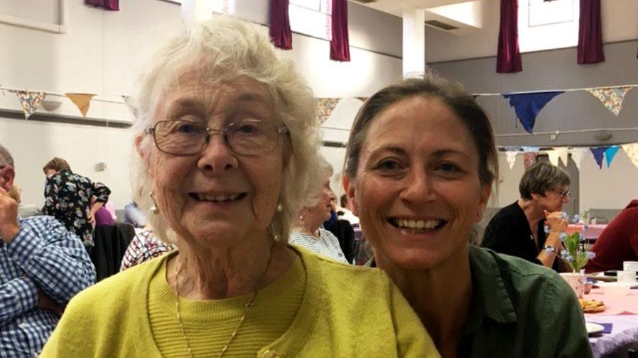 An elderly lady and a volunteer dementia befriender