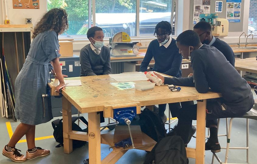 Mental health trainer Kirat and pupils at Newstead Wood School