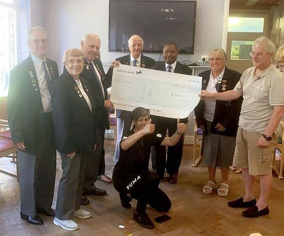 Members of the Beckenham, Bromley and District Bowling Association present a cheque to BLG Mind